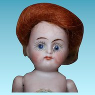 "Sweet little 4.5"" Prize Baby, German Antique all bisque doll, marked label on chest. small chip on right thigh, see picture. auburn mohair wig. no clothes."