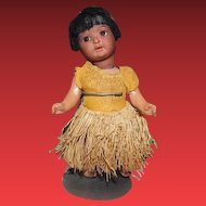 "Schoenau & Hoffmeister German Antique doll, Character Hanna doll dressed as an Island Girl! Grass skirt and and cloth dress, mohair wig, sleep  eyes. 7"" tall in size."