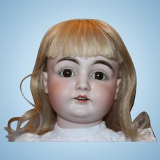 "25 1/2"" tall Antique German Kestner #146 doll, free of hairlines.  Original Plaster pate, human hair blond wig, French Pique dress! Upper leg has a split."