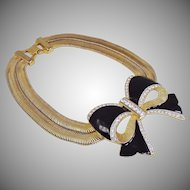 Les Bernard enamelled bow and snake chain necklace