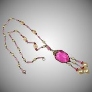 A vintage 1930's Czech pink glass lavalier necklace