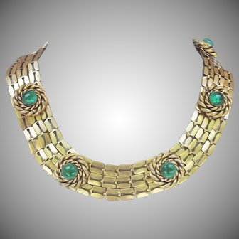 Vintage 1950's gold tone articulated link collar necklace in the Romanesque style.