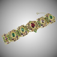 Hobe (unsigned) filigree rhinestone set articulated panel bracelet.