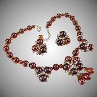 Vintage 1940's French amber poured glass bead necklace and earring set.