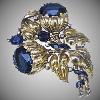 Trifari, Alfred Philippe, sapphire blue floral fur pin.