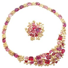 A vintage 1968, Christian Dior, Germany, gold tone Demi Parure with ruby and amethyst rhinestones.