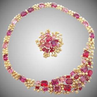 A vintage 1968, Christian Dior, Germany, gold tone necklace with ruby and amethyst rhinestones.