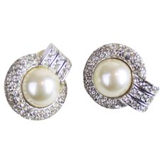 Christian Dior faux mabe pearl and rhinestone earrings.