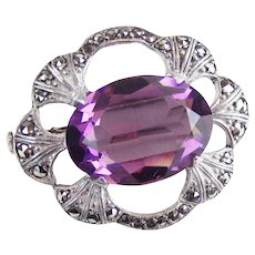 French 1930's silver and marcesite brooch set with a large amethyst paste stone.