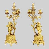 Pair of Louis XVI style gilt bronze 3 light figural candelabra candleholders