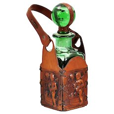 Antique German hand blown green glass decanter or bottle in leather holder