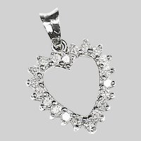 Fine 14k white gold Heart pendant set with .80C diamond