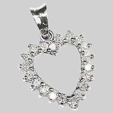 Fine 14k white gold Heart pendant set with .80C diamond