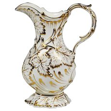 Antique porcelain water pitcher white with gold accent on relief foliage