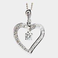 Romantic 0.45 cwt Diamond Heart shape pendant and  chain 18 karat white gold circa 1960 s