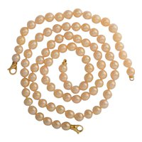9 mm Cultured Pearl necklace with a matching bracelet two 18 k yellow gold clasp