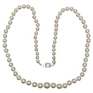 Bridal elegant cultivated pearls necklace Art Deco diamond  0.50 carat clasp circa 1930