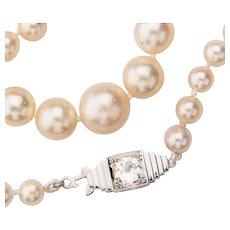 Pearls necklace 0.50 ct diamond H-I / VS Art Deco clasp circa 1930