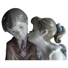 Lladro 7635 Ten and Growing Girl and Boy Kiss on Bench Retired w/ Box
