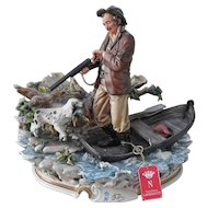 Capodimonte Figural Duck Hunter Retriever Dog in Boat Figurine