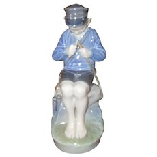 Royal Copenhagen Boy Whittling Figurine 905