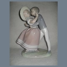 Lladro Precocious Love Boy Girl Kissing Figurine 4856