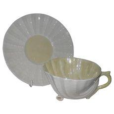 Belleek Neptune Yellow Shell Teacup and Saucer