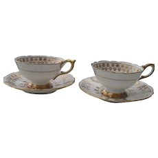 Pair of Royal Stafford Gold Encrusted Teacups and Saucers