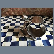 Antique Pairpoint Silverplate Standing Cherub Napkin Ring