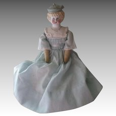 Bisque Head Doll On Cloth Body
