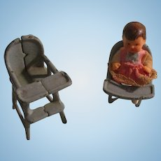 Metal highchairs and baby for your miniature doll house.