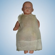 German Celluloid Baby Doll In Original Clothes