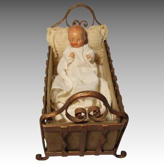 Vintage Metal Doll Crib with German Baby Bisque Doll.