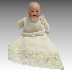 Antique Baby German Bisque Doll In Original Outfit.
