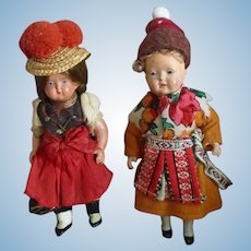 Two Celluloid Dolls In Original Clothes
