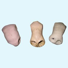 Three vintage doll bodies.