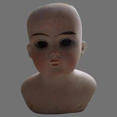 Antique Doll Head.