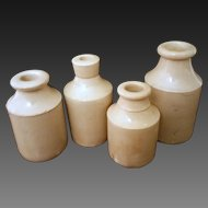 Grouping of antique stoneware ink bottles