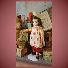 Rar small doll in original harleqiun costume