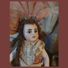 Rar mignonette in antique dress