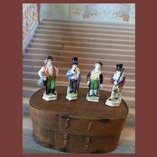 Four tiny porcelain figurines