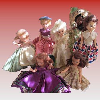 Vintage Lot of  7 / 1 Bisque/Celluloid StoryBook/ 1 K&H Dolls