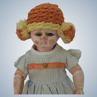 Early Wood Carved Doll with Glass Eyes Made for the French Market Bebe Tout en Bois