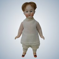 Darling Little German All Bisque Boy Doll with Swivel Neck