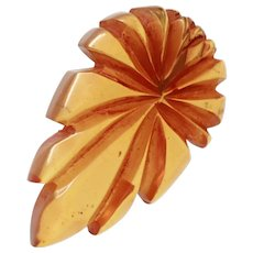 Large Translucent Apple Juice Bakelite Carved Figural Leaf Dress Clip  c1930s