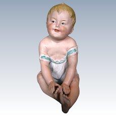 Large Gebruder Heubach Seated Boy Piano Baby