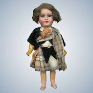 """Antique 7"""" German Scottish Bisque Head Doll"""