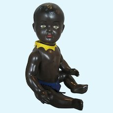 "Adorable 11"" French Black Celluloid Baby Doll with Glass Eyes"