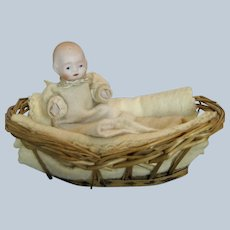 Sweet Little Miniature All Bisque Baby in Wicker Bed