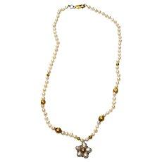 Pearl, 18 karat Gold and Gold Wax beads, 9 karat Handmade centrepiece.